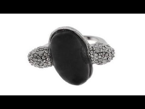 To buy now click on the link: http://shrsl.com/?~3f8k  The #Alexis #Bittar Extra Large #Black Oval #Ring features a black oval #glass center surrounded by two #Swarovski #crystal studded balls based on a #silver plated #ring. #Ring has a length of about 1 inch. At age 22 Bittar began designing and making #Lucite and #semi-precious #jewelry, selling it on the streets of Soho.