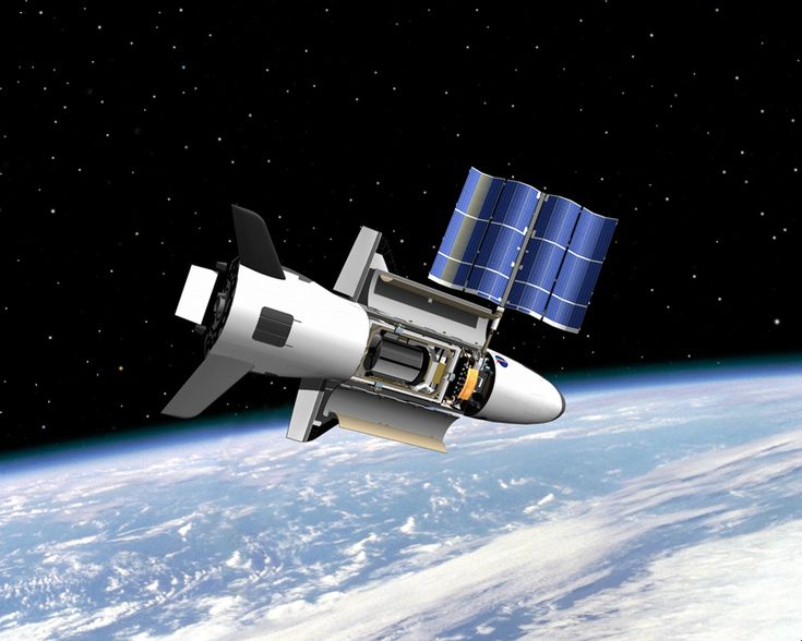 Artist's illustration of the U.S. Air Force's X-37B space plane in orbit. The mysterious spacecraft is scheduled to launch on its fourth mission on May 20, 2015.