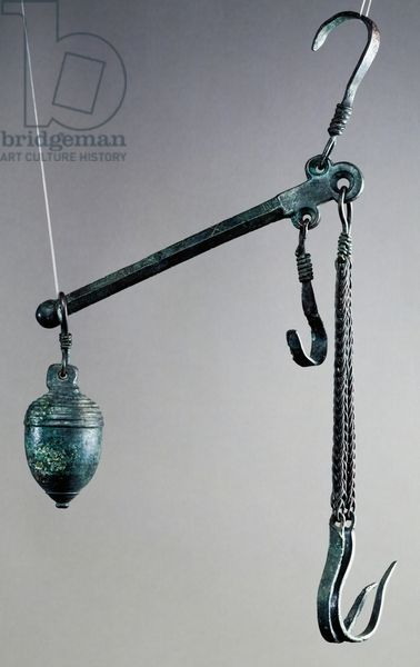 Steelyard balance with bronze hook for hanging goods to weigh and acorn counterweight decorated with stripes at top, artifact uncovered in Pompeii, Campania, Italy, Roman Civilization, 1st century. Naples, Museo Archeologico Nazionale (Archaeological Museum)