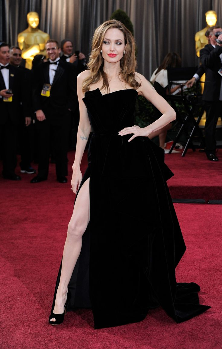 Thanks to her fierce leg pose, this velvet Atelier Versace look will be an iconic Oscars look for decades to come.   - MarieClaire.com