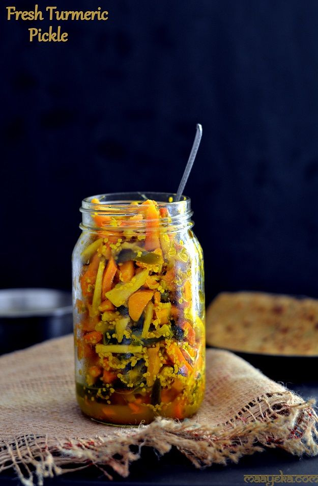 A healthy and tangy pickle of fresh turmeric ,ginger and green chilies