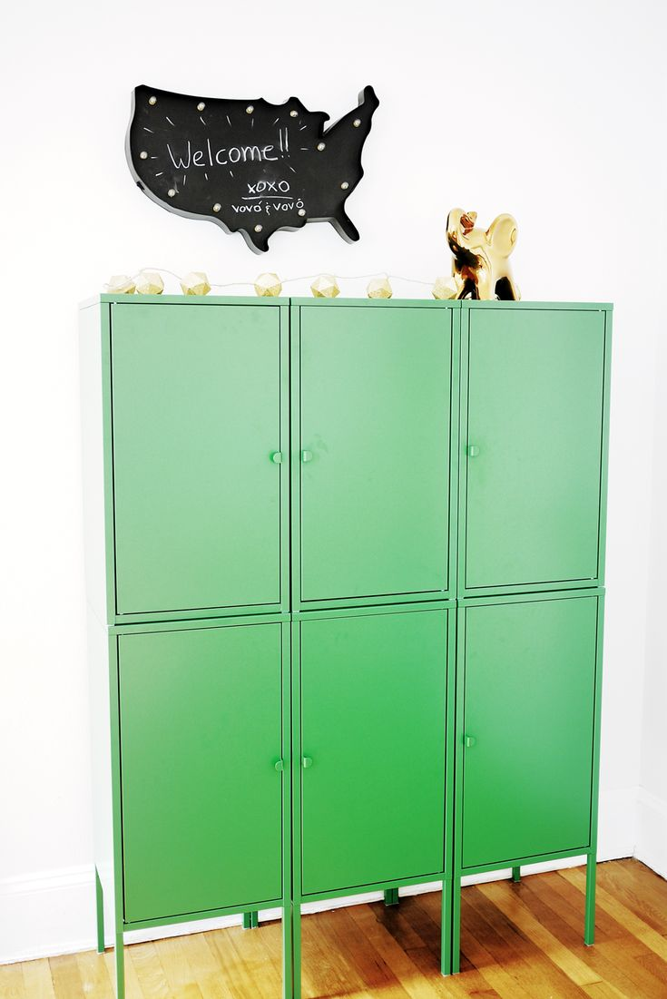 Green locker in a shared kids room at Grandma's house - love that each grandkid has a space to store their things!