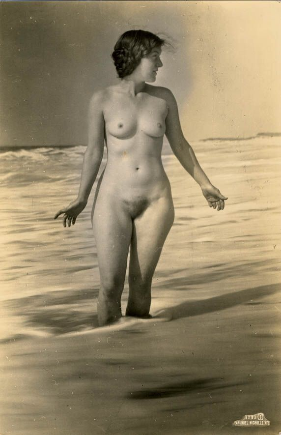 Woman washing clothes nude