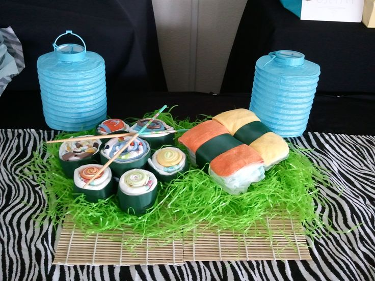 This is a diaper cake made to look like sushi rolls and sashimi :) super easy to make and is a favorite among guest at a baby shower!! Forget the traditional diaper cake...try something new! Designed by AT (me)