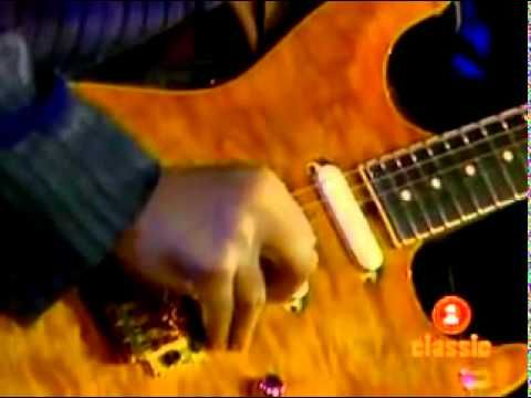 Sultans of Swing - Dire Straits (live) featuring Mark Knopfler and guest Eric Clapton.