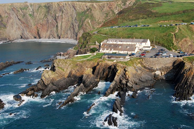 One of the most spectacular locations for food, the Hartland Quay Hotel, Hartland Quay, nr Hartland, North Devon, England, UK. Great for bar snacks & drinks when walking along the coastal path.