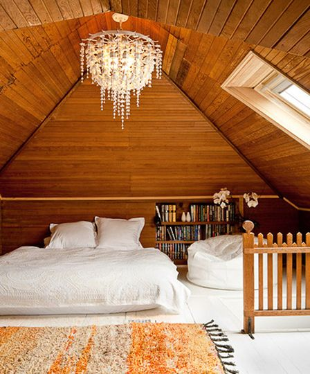 Have been looking at cabin-y houses w/ lots of wood panels. Love how the chandelier looks w/ them.
