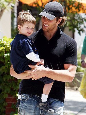 tom brady with his son. He's a good family man.