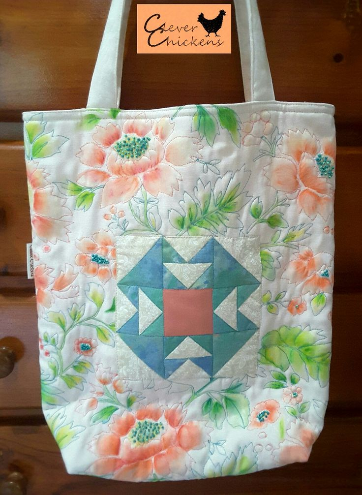 Quilted tote bag featuring hand-pieced central patchwork block surrounded by hand-painted and beaded fabric.