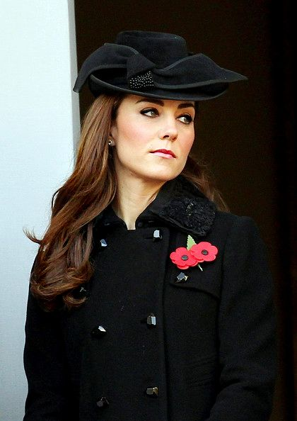 "Duchess Catherine in black Diane von Furstenberg coat, black Jane Corbett hat, and Kiki McDonough ""Grace"" earrings at Remembrance Day ceremony, November 2011"