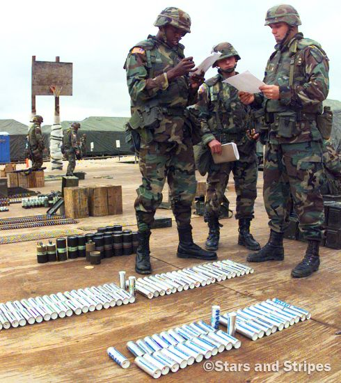 Camp Bedrock, Bosnia and Herzegovina, September, 1998: As the 1st Cavalry Division takes over peacekeeping duties from the 1st Armored Division, 1st Lt. Kelvin Brown, Sgt. Jeremiah Walter and 1st Lt. Karl Warnsman, left to right, take inventory of ammunition and nonlethal projectiles before signing for and accepting the assets. The 1st Cav was deployed from Fort Hood, Texas, and the 1st Armored was on its way back to Germany. (Ron Alvey ©Stars and Stripes)