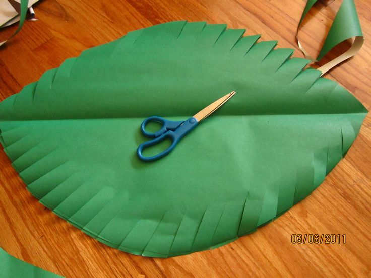 Cutting palm leaves out of butcher paper