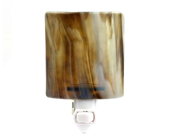 This pretty nightlight is made with art glass that exhibits a wispy, streaky mix of brown hues. This one will make a nice accent for your earthy brown decor.  Night Light  Brown Wispy Stained Glass Light  by InFashionGlass