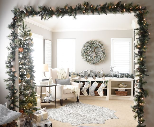 Now this is how you make an entrance! Shop festive artificial garland in the Martha Stewart Living Holiday Collections. (Photo by @honeywerehome)