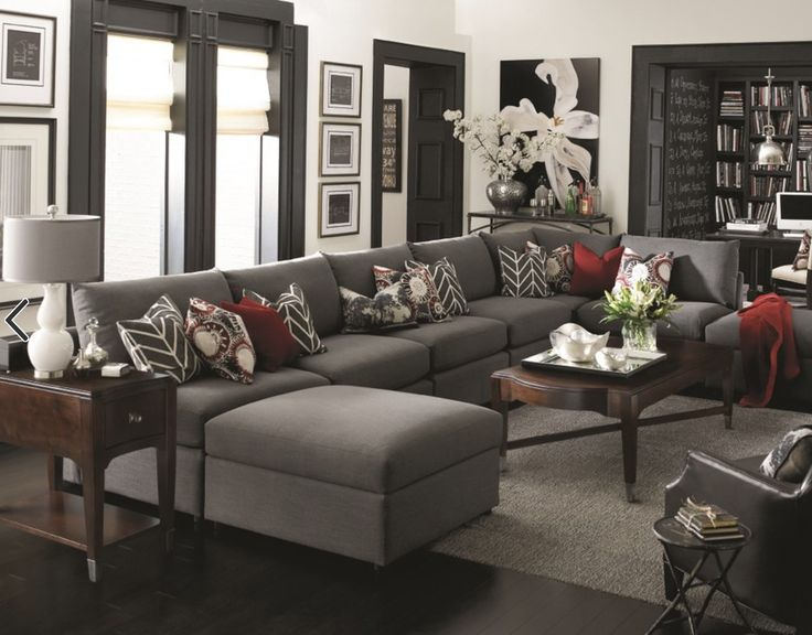 Dark tones will make your living room the perfect place to relax- especially with the perfect sofa!