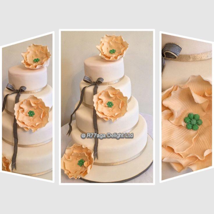 Ivory Stylish & elegant wedding cake of vanilla & biscotti buttercream with hand designed edible flowers. http://www.facebokk.com/R77aga