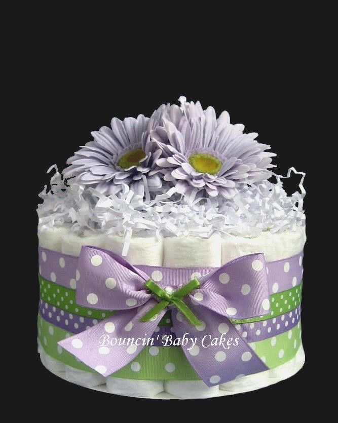 Use formula can as center, surround with rolled diapers, decorate and fill with theme/color scheme as center piece. How about....Make as a table centerpiece! Use a mason jar in the center and fill with flowers!