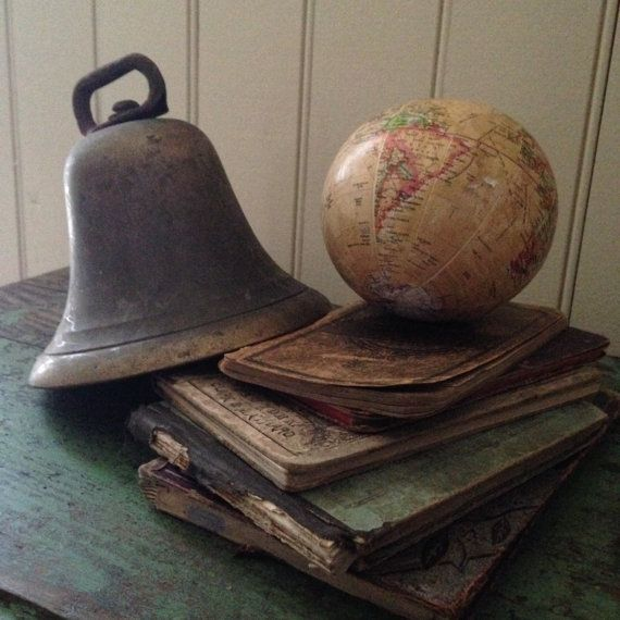 The most unique attribute to this large antique brass bell is undoubtedly the clapper! I do not believe it is original (it looks to be attached by