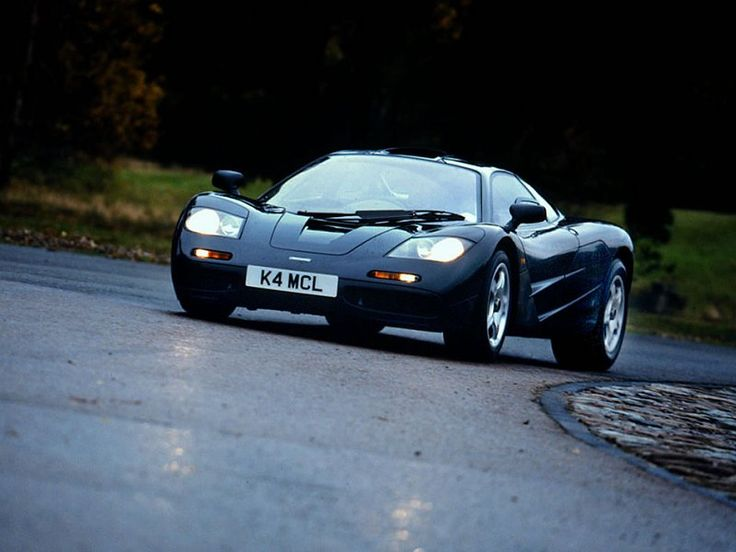 McLaren F1:  240 mph, 0-60 in 3.2 secs. BMW S70/2 60 Degree V12 Engine with 627 hp, base price is $970,000. The fastest car in the 20th century with doors that looks like bat wings. Maybe Batman needs to order one and paint it black.