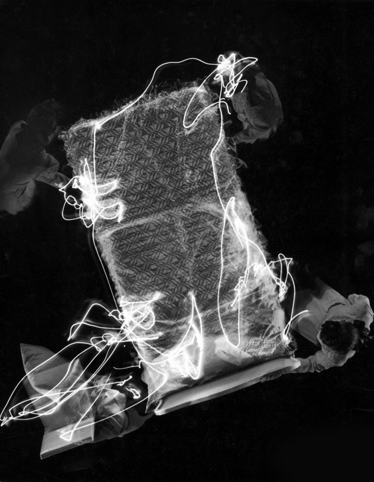 Gjon Mili: Pattern of light streaks created in multiple exposure for time and motion study reveal how an efficient housewife makes a bed. 1946