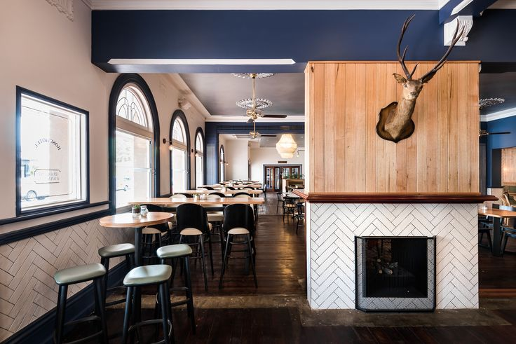 Hospitality Design by Benson Studio. Bar design with double sided fire place at the Historic Rose Hotel in Western Australia. Creates warm welcoming atmosphere