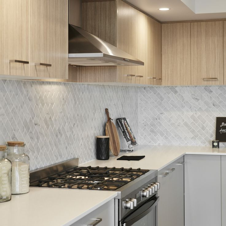 #twotone #kitchen #gascooking #herringbonetiles #splashback #timber #grey #cupboards #kitchenstyling