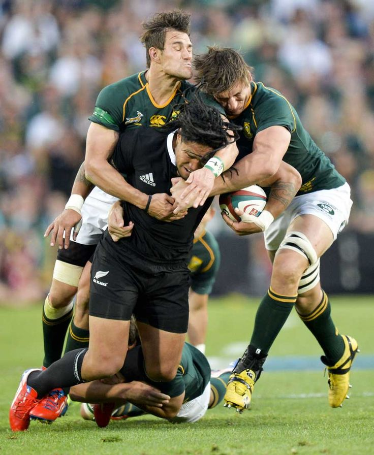 New Zealand's Ma'a Nonu is snuffled up by the South African defence