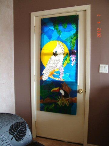while I am not very artistic I love the effects of stained glass painting on a plexi glass insert. Gives complete privacy while allowing the sunlight to create magic.