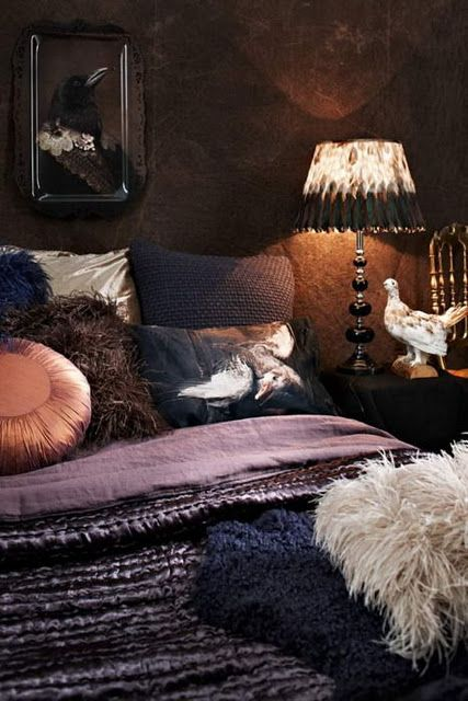 bird art, feathered lampshades, dark walls in this murky muted monochrome bedroom....