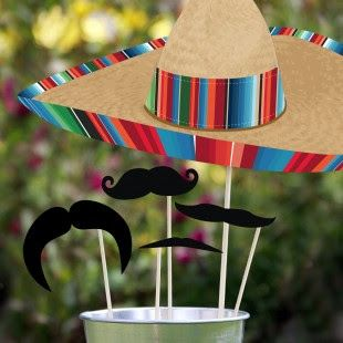 mexican party photo booth- hold the props in the galvanized bucket with pinto beans