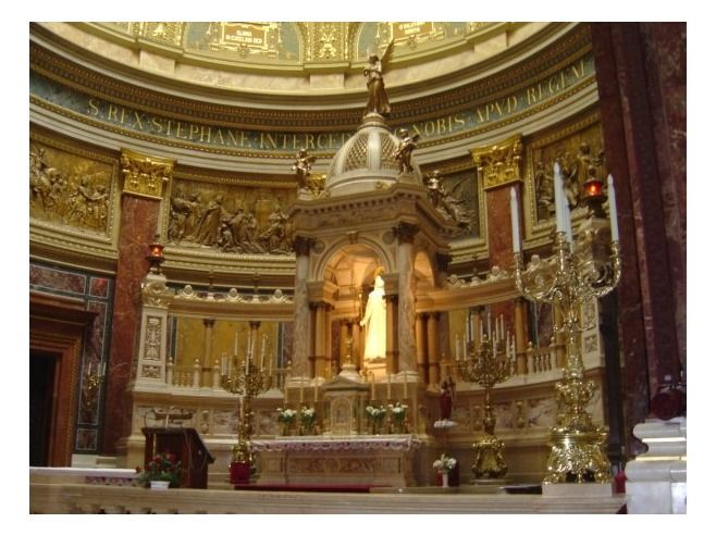 St. Stephen's Basilica or Szent István-bazilika. Main Altar: statue of St. Stephen carved out from Carrara marble by Alajos Strób. The Patrona Hungariae Altar by Gyula Benczúr depicts St Stephen offering the Hungarian Crown to the Virgin Mary and asking her to be a patron of Hungary: