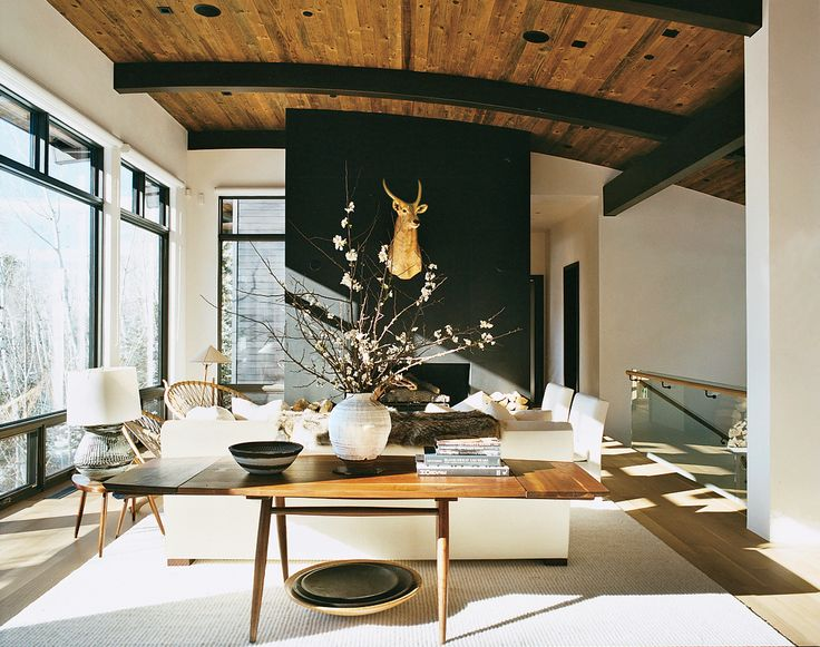 aerin lauder's aspen home (photo by francois halard for vogue magazine) a george nakashima table and oversize wooden bowls in the living room