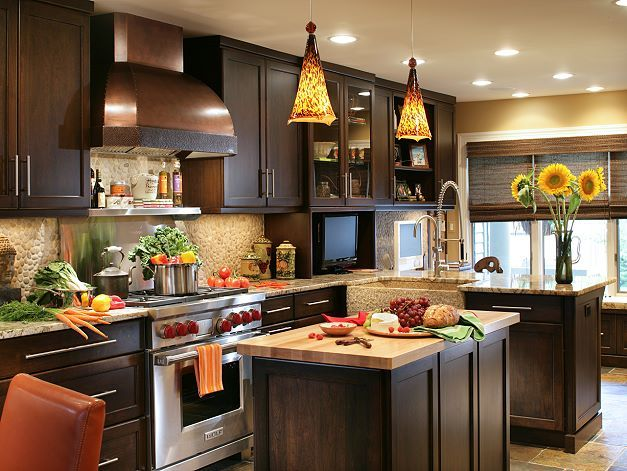 Love the warm tones deep brown orange dark yellow gorg for Dark orange kitchen