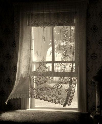 vintage lace curtains on the bedroom windows