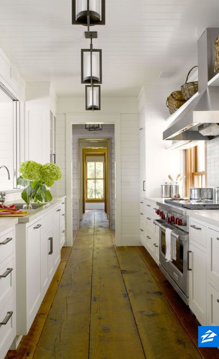 Celebrate the layout of your galley kitchen with pendant lights spaced throughout the length of the room.