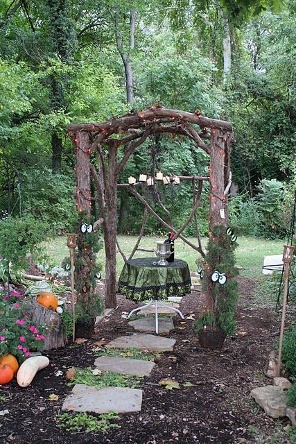 rustic gazebo... the hanging lighting and the table seating.  how charming would this space be in the evening?!
