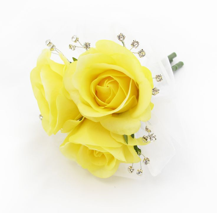 A tiny posy of yellow Fresh Touch Roses with diamantes and an organza surround. Find your perfect wedding flowers at http://www.loveflowers.com.au
