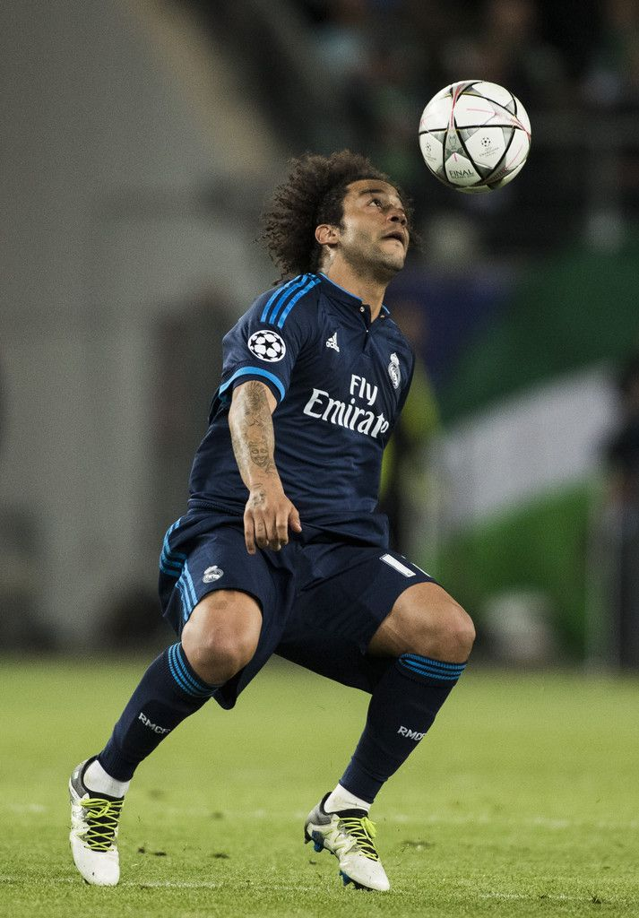 Real Madrid's Brazilian defender Marcelo controls the ball during the UEFA Champions league quarter-final, first leg football match between Wolfsburg and Real Madrid in Wolfsburg on April 6, 2016.