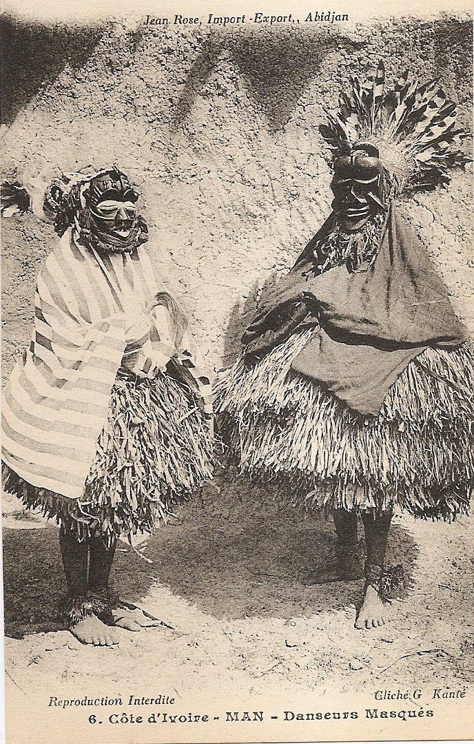 """Masked dancers"", town of Man, western Ivory Coast, circa 1910, Dan or Guere ethnic group. Vintage postcard, photographer G. Kante."