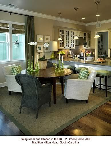 Green accent, grass cloth rug, open to kitchn. Round table, low comfy
