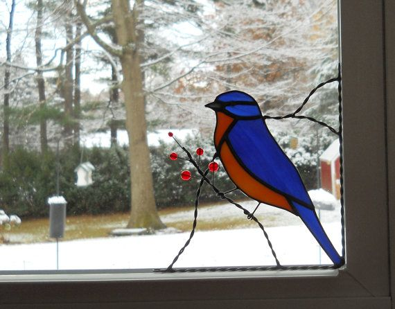 Size: approximately 6 1/2 x 6 HxW. Position: bottom left corner. We offer color options for the berries.  Birds are joyful creatures. Whether you watch them in the wild, at a bird feeder or see them in your window as a lovely corner design, they are colorful and cheery. I have two windows full of bird and vine corners in my work room and the light glowing through the colors is warm and inviting and just makes me feel good.  Maybe you or someone you know would enjoy the charm our birds bring…