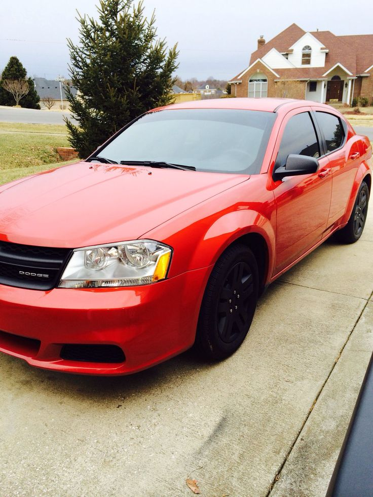 Beautiful red Dodge Avenger W/ nice black wheels