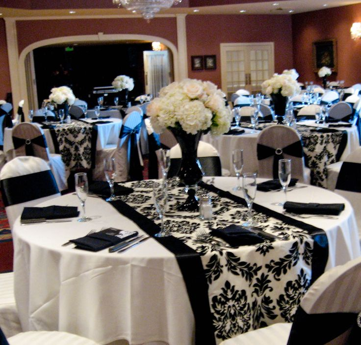 Dramatic black and white wedding reception.  I like the light blue with it, but I hate those flowers.