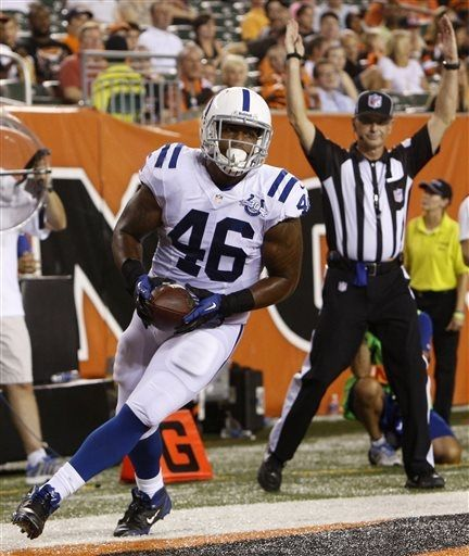 Indianapolis Colts tight end Dominique Jones (46) scores on a 7-yard touchdown pass in the second half of an NFL preseason football game against the Cincinnati Bengals, Thursday, Aug. 29, 2013, in Cincinnati. (AP Photo/David Kohl)
