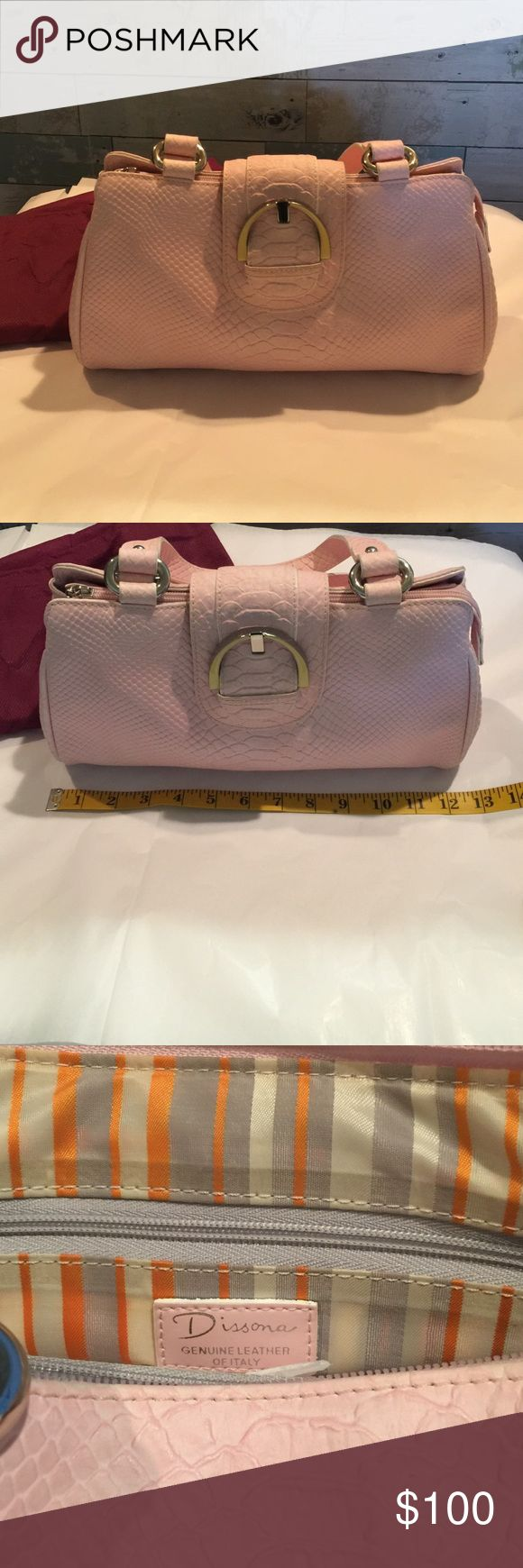 """Dissona leather handbag light pink Dissona leather handbag light pink. EUC mild wear on side of straps. Dimensions: 12"""" long 7"""" deep 3"""" max width. Clean interior with 2 easy accessible pockets, and 2 zippered pockets. Very cute bag!! Dissona Bags Mini Bags"""
