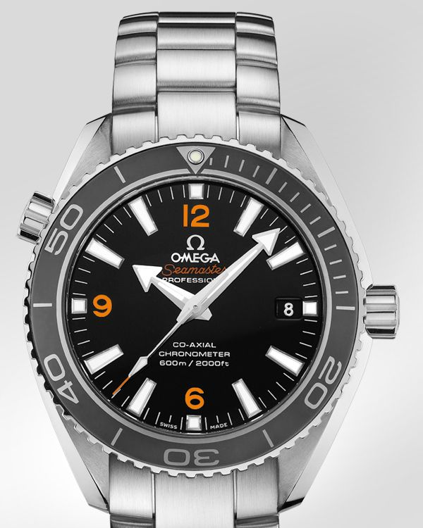 Omega Seamaster Planet Ocean. Okay, I take that back. THIS is the one I want next. Automatic, with a helium escape valve for dives, day date, second hand movement, and orange accents. Yep, this is the one.