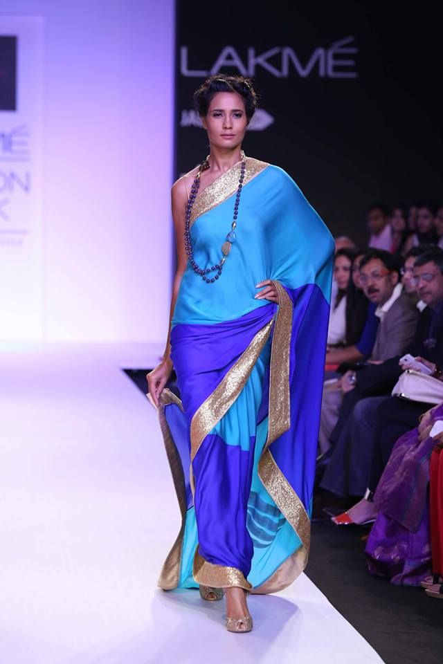 Mandira Bedi Lakme Fashion Week Summer 2014 blue shades and gold sari. More here: http://www.indianweddingsite.com/mandira-bedi-lakme-fashion-week-summer-resort-2014/