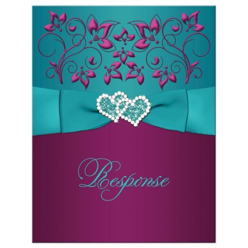 The rich jewel tones of this wedding response card in deep teal blue-green with dark purple and magenta pink flowers are a lovely combination for a fall or winter wedding. There is a teal blue printed on ribbon and bow with a pair of printed on diamond jewels and glitter joined hearts buckle brooch. The back of this wedding RSVP card has an ornate purple scroll frame surrounding the wedding wording and another pair of smaller joined hearts appear at the top. This wedding reply card would…