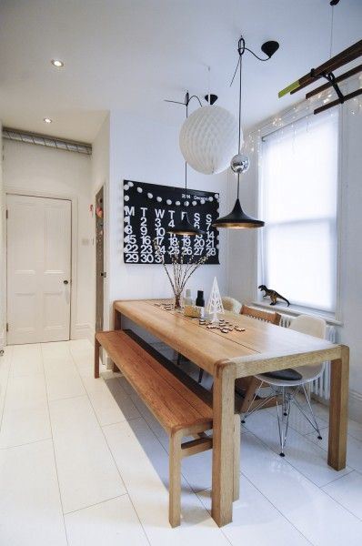 Solid wood tables and benches in MADE customer Cat's home give an effortlessly Scandi feel. MADE.COM/Unboxed