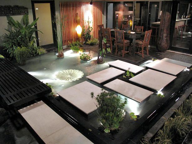 Bali was the inspiration for this makeover: Jamie turned the entire courtyard into a water feature. Stepping stones cross the tranquil pool; an infinity edge supplies the relaxing sounds of water in motion.